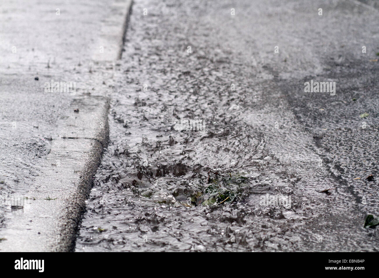 flooded gutter and gully caused by heavy rain, Germany - Stock Image