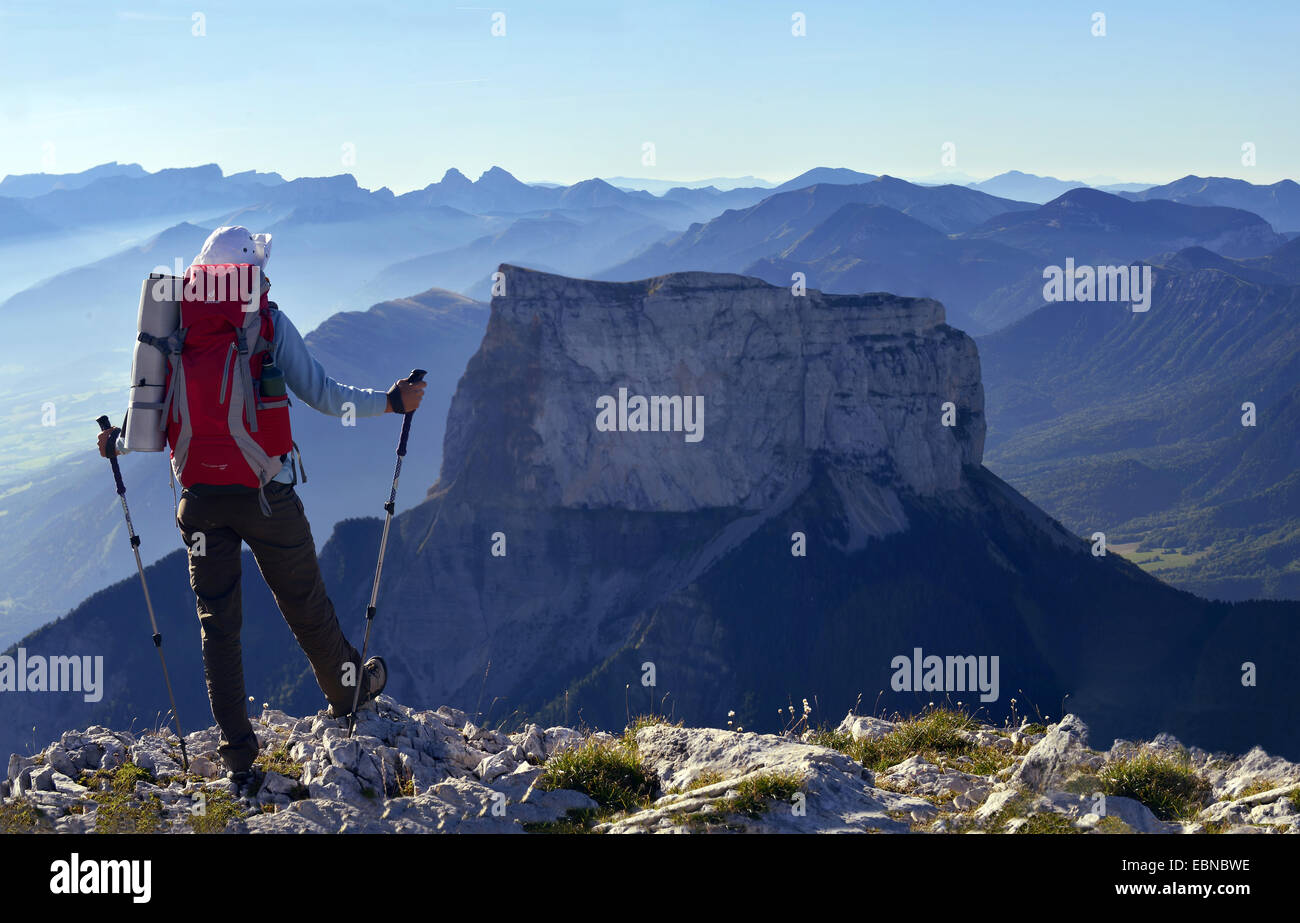 mountain hiker enjoying the view to Mont Aiguille in natural park of Vercors, France - Stock Image