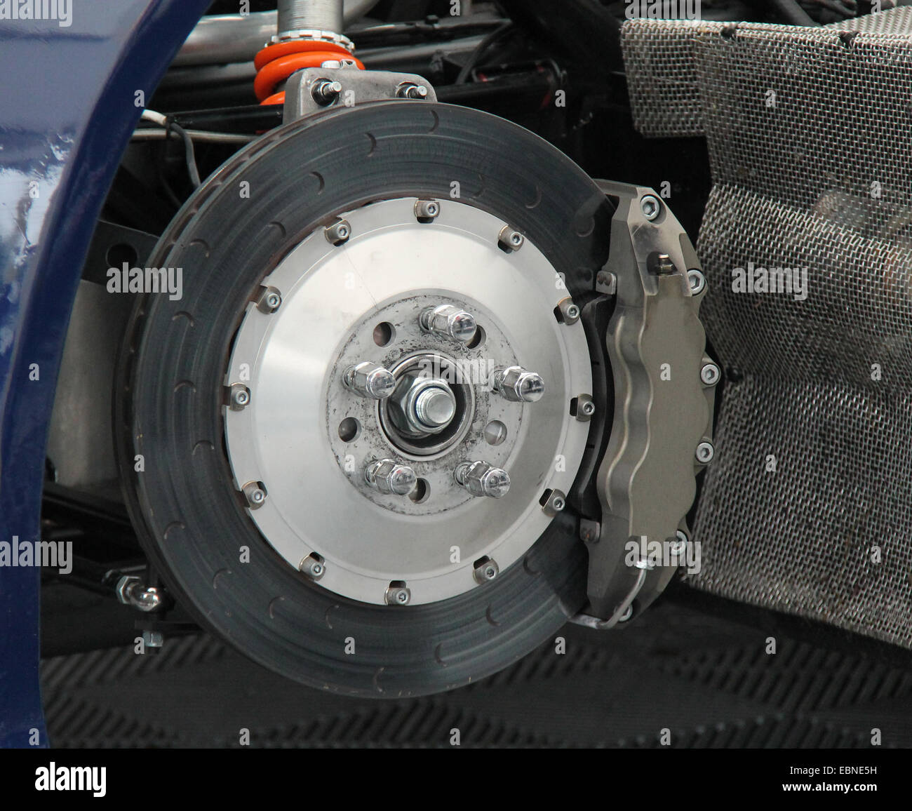 The Front Wheel Brake of a Fast Saloon Car. - Stock Image