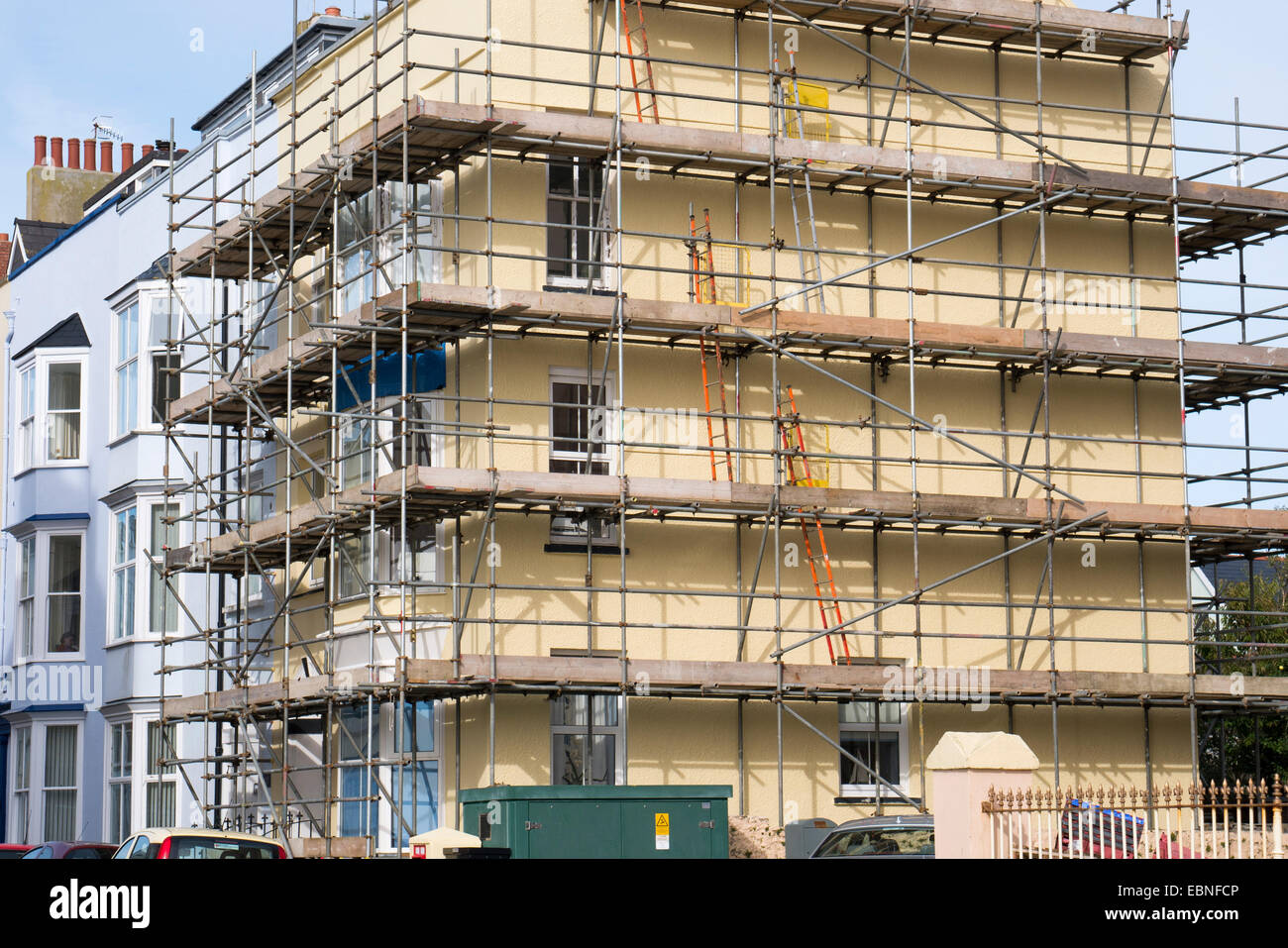 Scaffolding on property for repair - Stock Image
