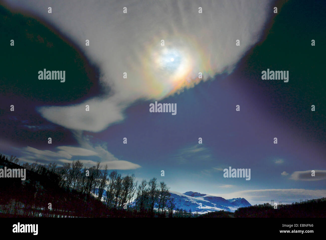 colourful cirrostratus with sun, Norway, Troms, Sandvik - Stock Image