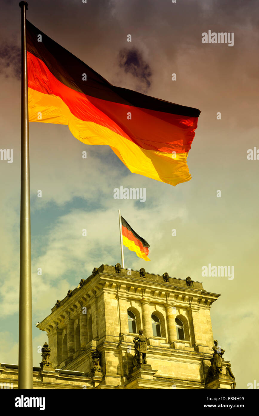 German flag blowing on Reichstag, Germany, Berlin Stock Photo