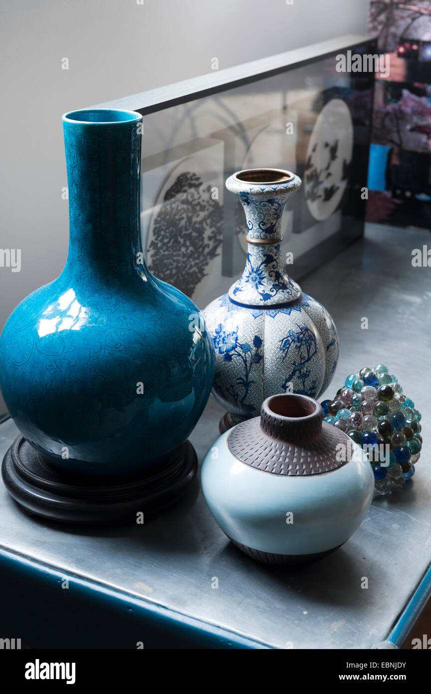A collection of three vases in shades of blue. - Stock Image