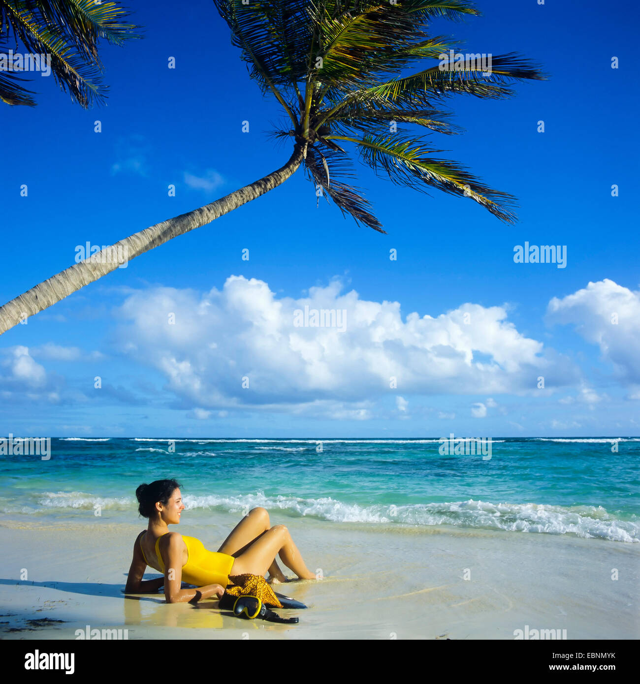 Caribbean Beach: Young Woman Sunbathing On Caribbean Beach, Guadeloupe