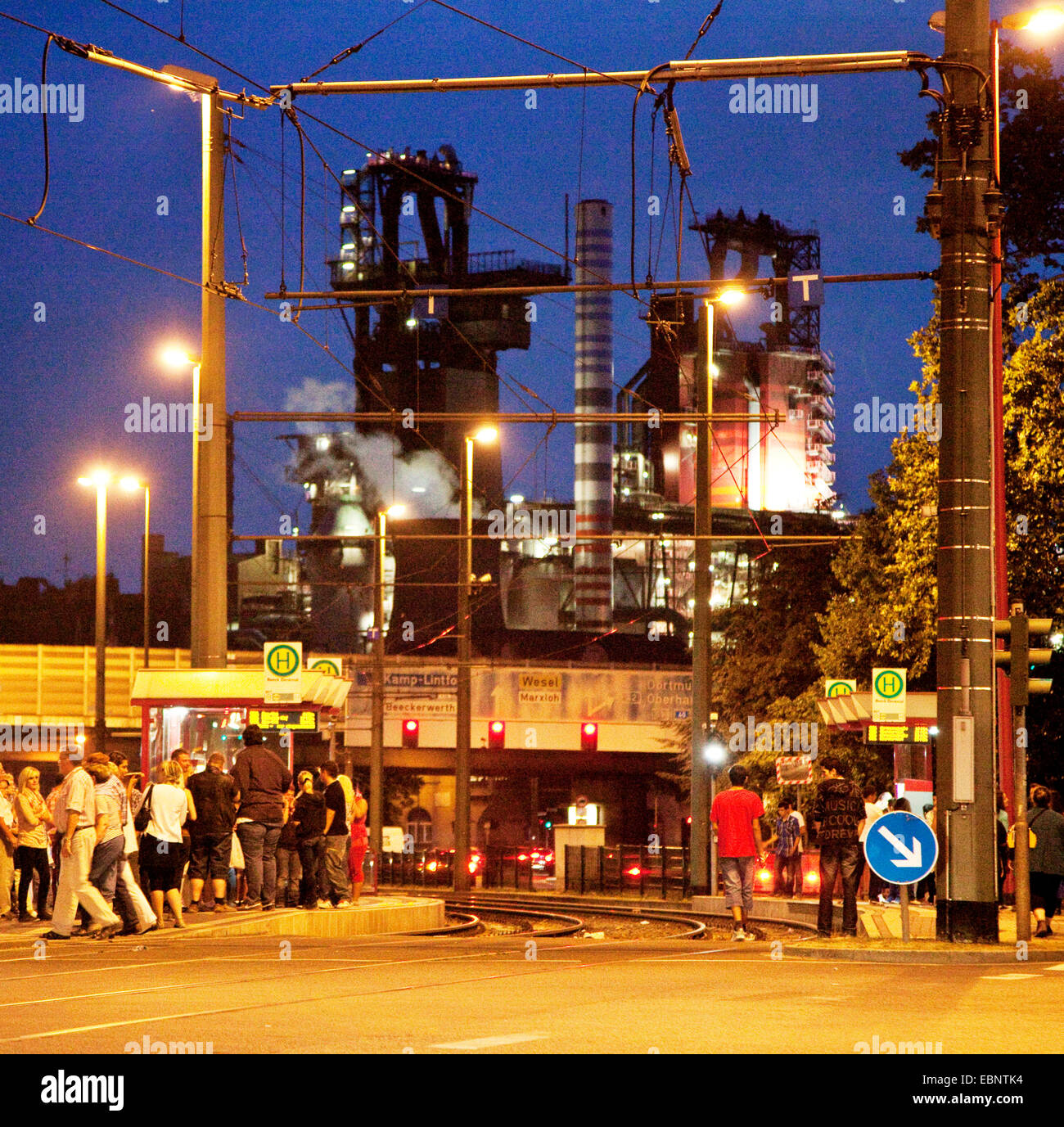 tram station at district Beeck in front of the blast furnaces of the steel mill Beekerwerth at dusk, Germany, North - Stock Image