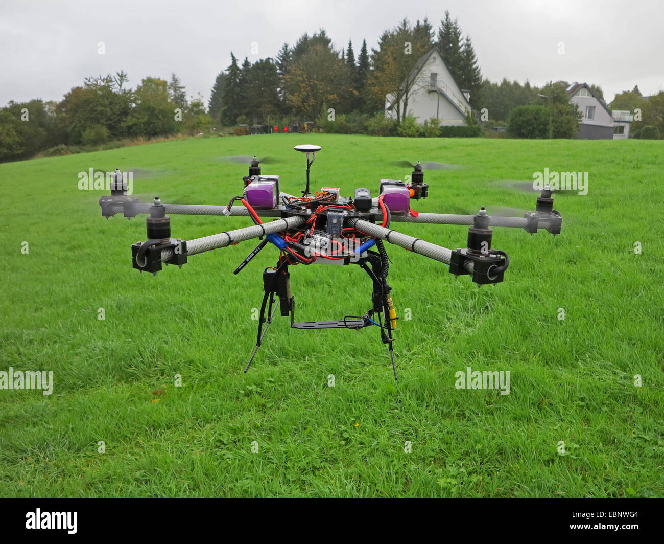 civil drone flying above meadow, Germany - Stock Image