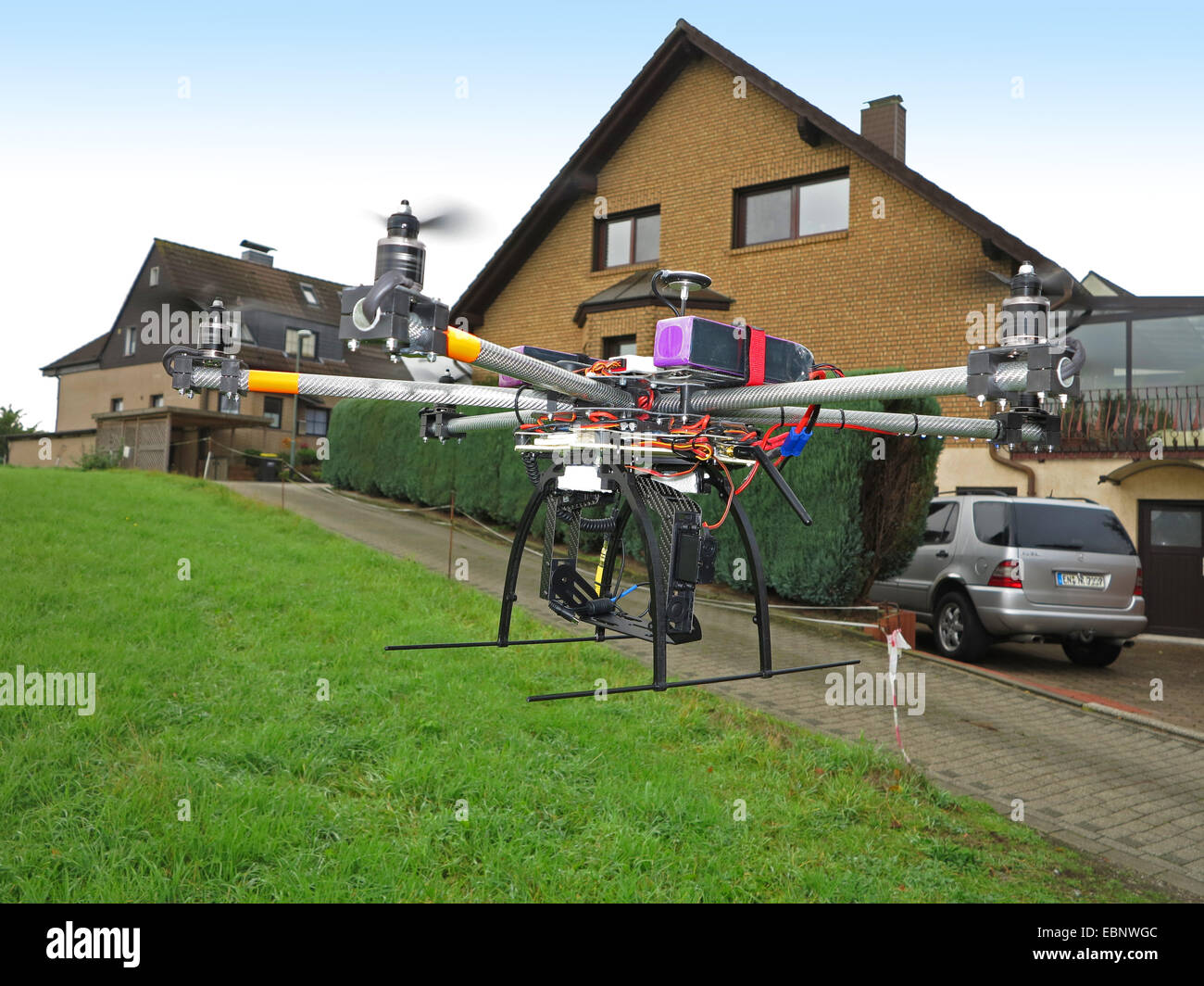 civile drone flying on the edge of a residential area, Germany - Stock Image