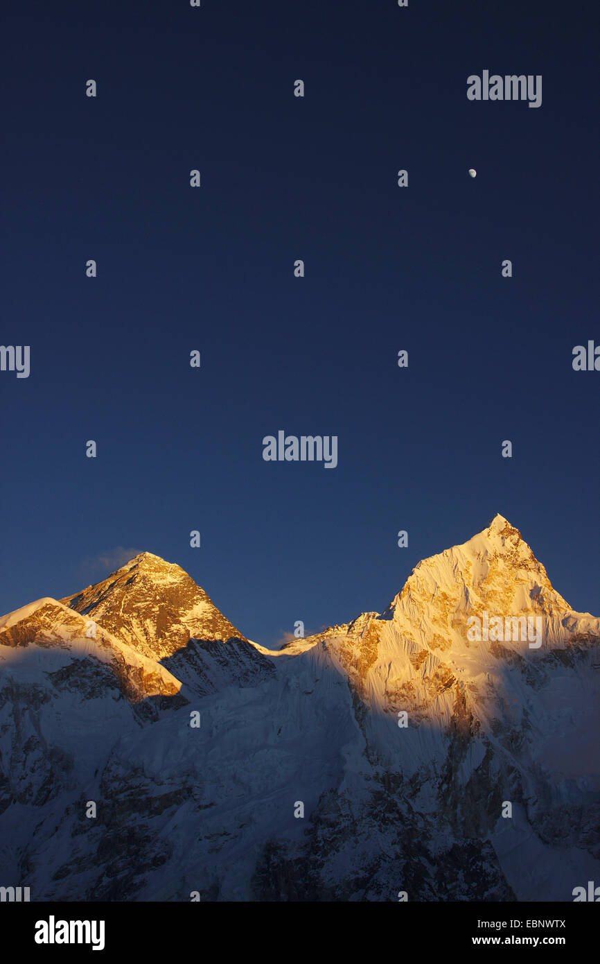 Mount Everest, Nuptse and moon in evening light. View from Kala Patthar., Nepal, Himalaya, Khumbu Himal - Stock Image