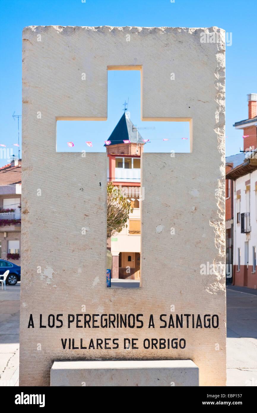 Way of St. James, cross with church, Spain, Castile and Leon, Leon, Villares de Orbigo - Stock Image