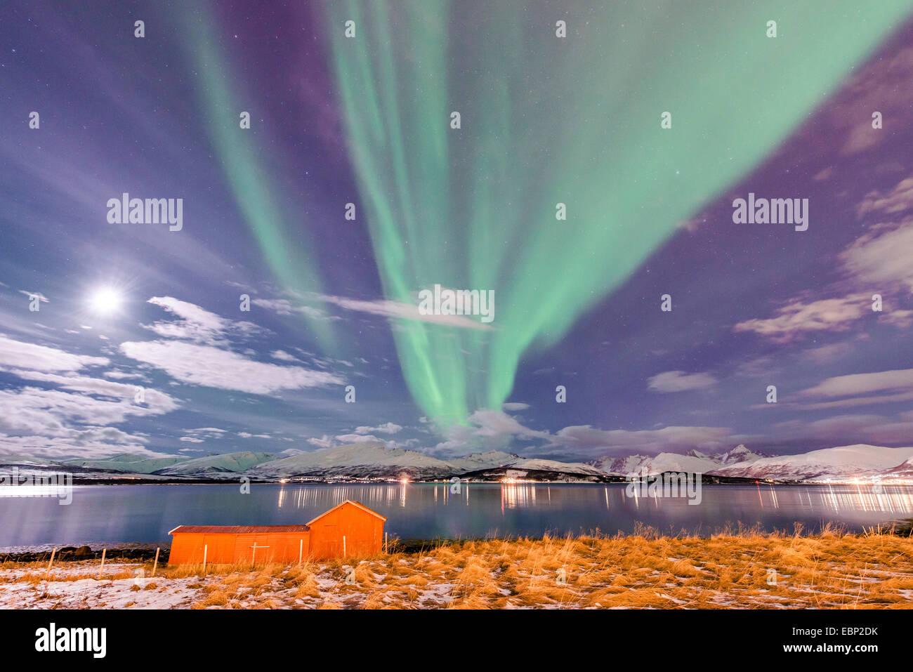 moon and aurora above Sandnessund, Norway, Troms, Tromsoe, Sandnessund - Stock Image