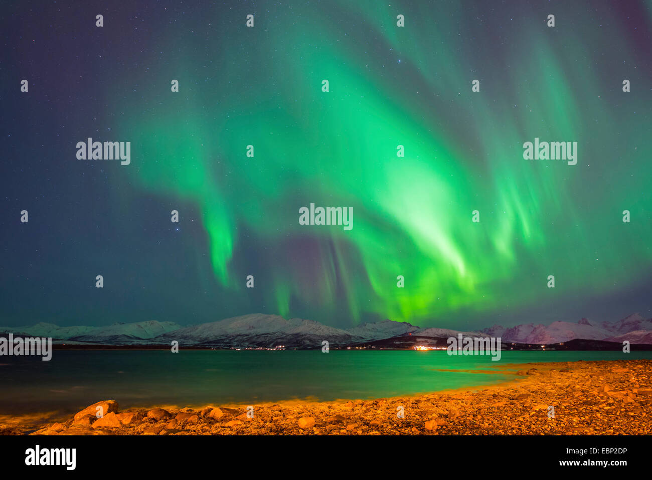 norther lights above Kvaloeya, Norway, Troms, Tromsoe, Sandnessund - Stock Image
