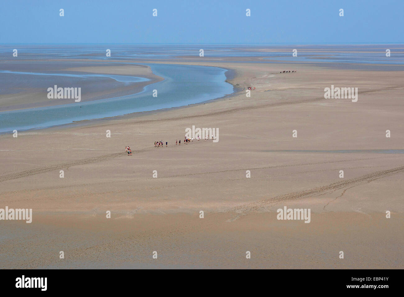 sandy tideland at low tide with tidal flat hikers, France, Brittany Stock Photo