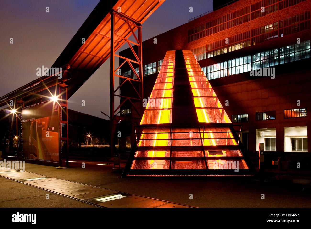 illuminated gangway to the visitor centre of Zollverein Coal Mine Industrial Complex, Germany, North Rhine-Westphalia, - Stock Image