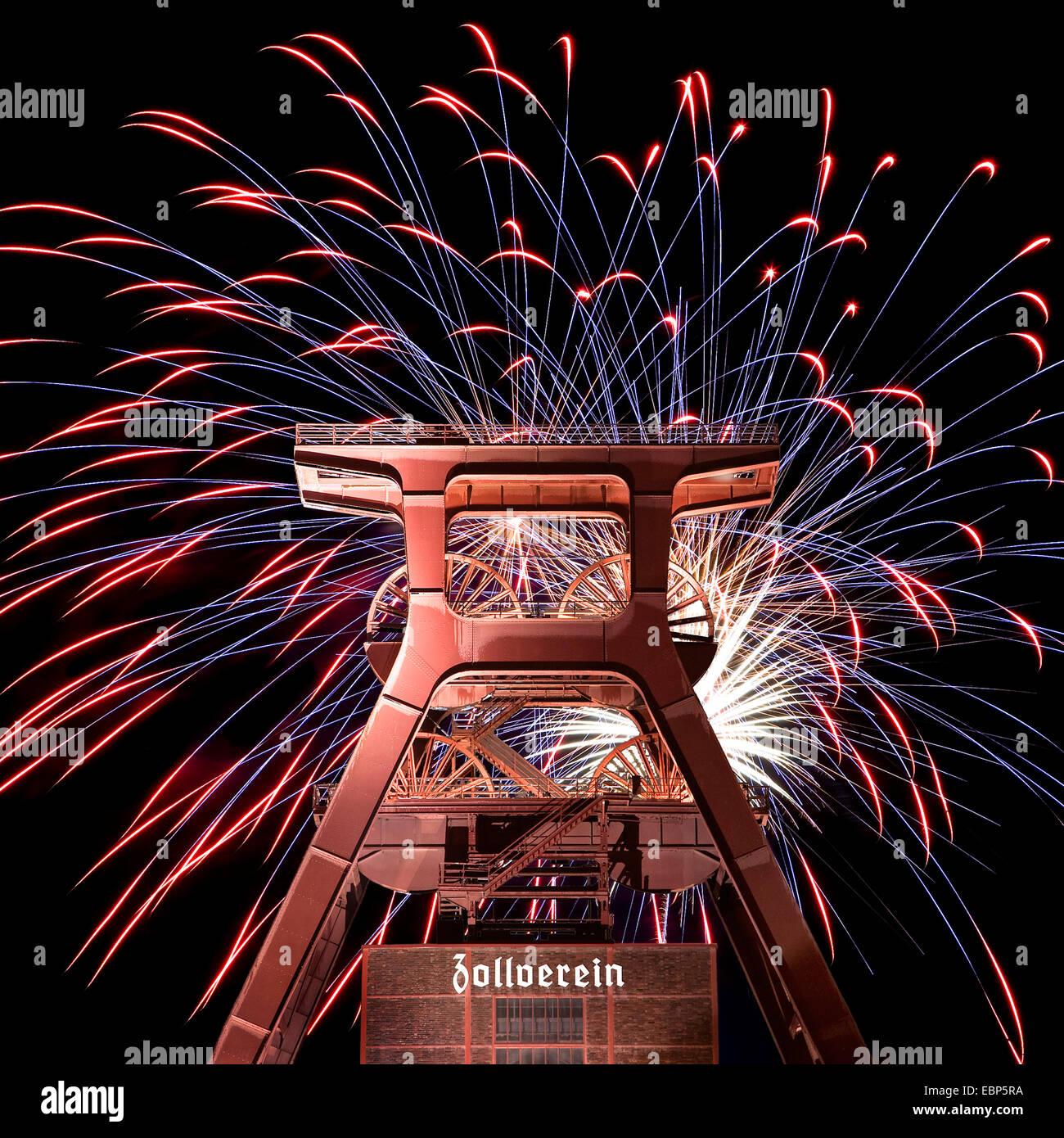 fireworks at Zollverein Coal Mine Industrial Complex at night, Germany, North Rhine-Westphalia, Ruhr Area, Essen - Stock Image