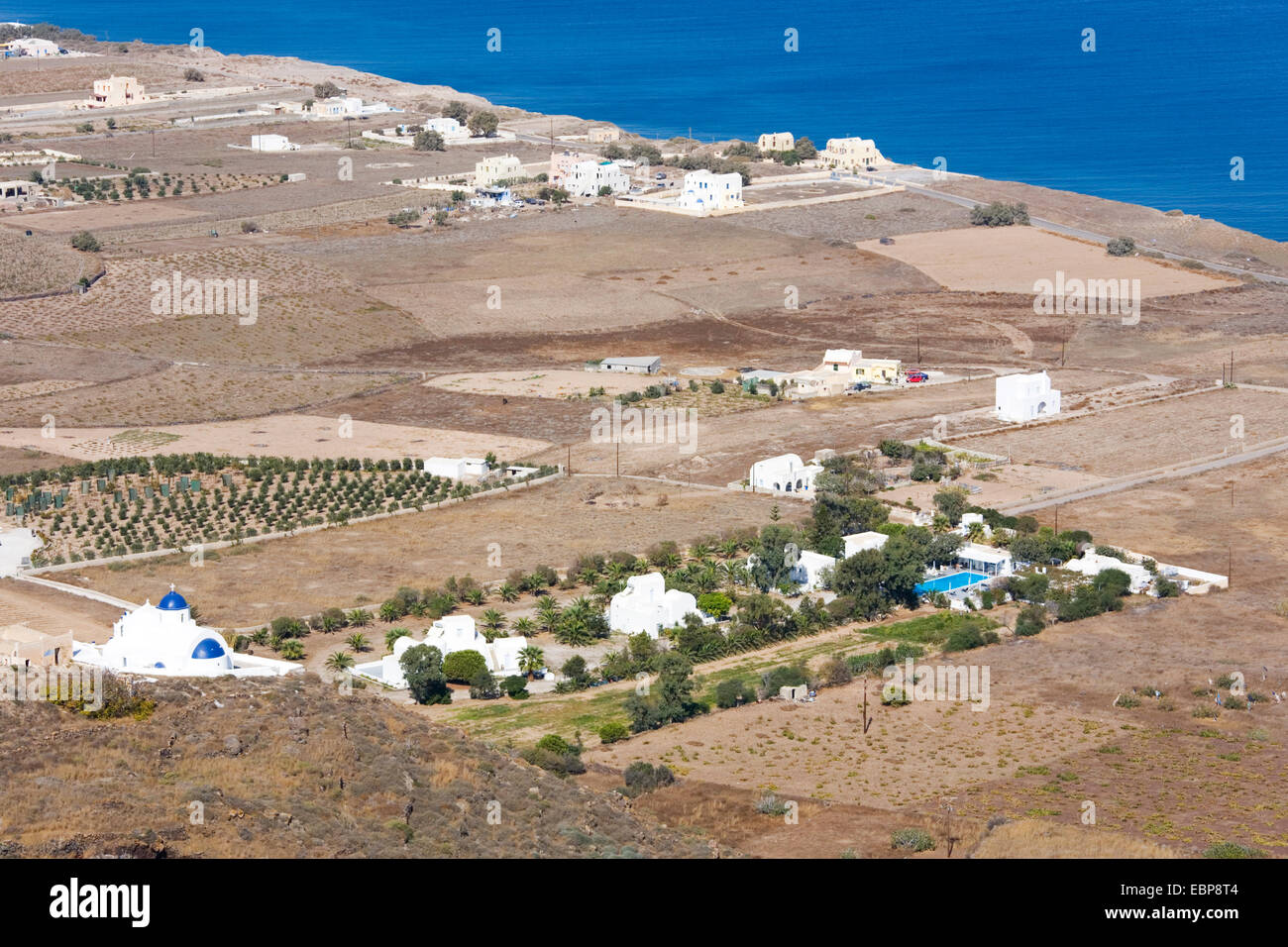 Ia, Santorini, South Aegean, Greece. View over the island's arid coastal plain from hillside near Finikia. - Stock Image