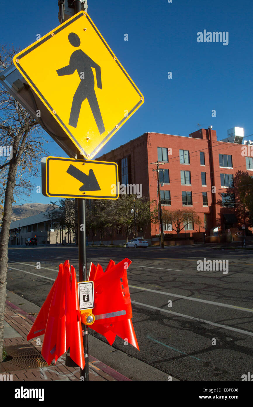 Salt Lake City, Utah - Crosswalk safety flags at a pedestrian street crossing. - Stock Image