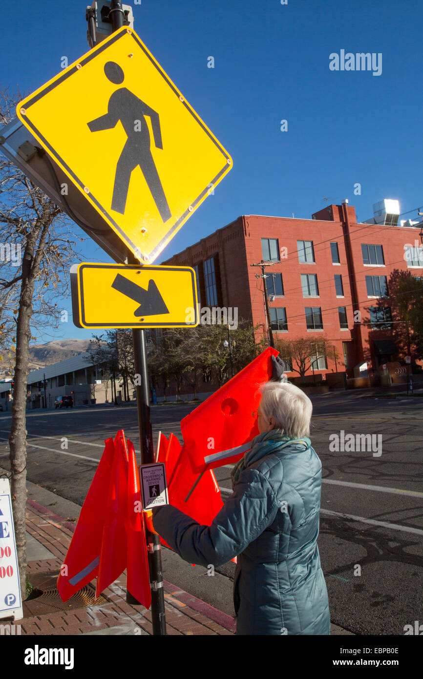 Salt Lake City, Utah - Crosswalk safety flags at a pedestrian street crossing. - Stock Image