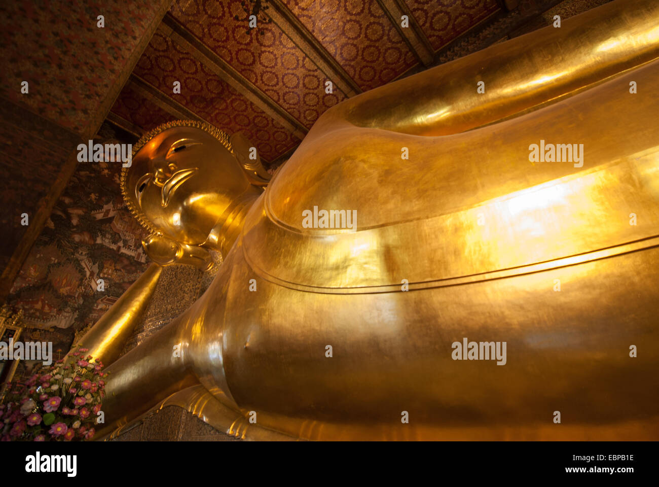 The reclining buddha is one of the largest in Thailand and is situated in Wat Pho in Bangkok, Thailand - Stock Image