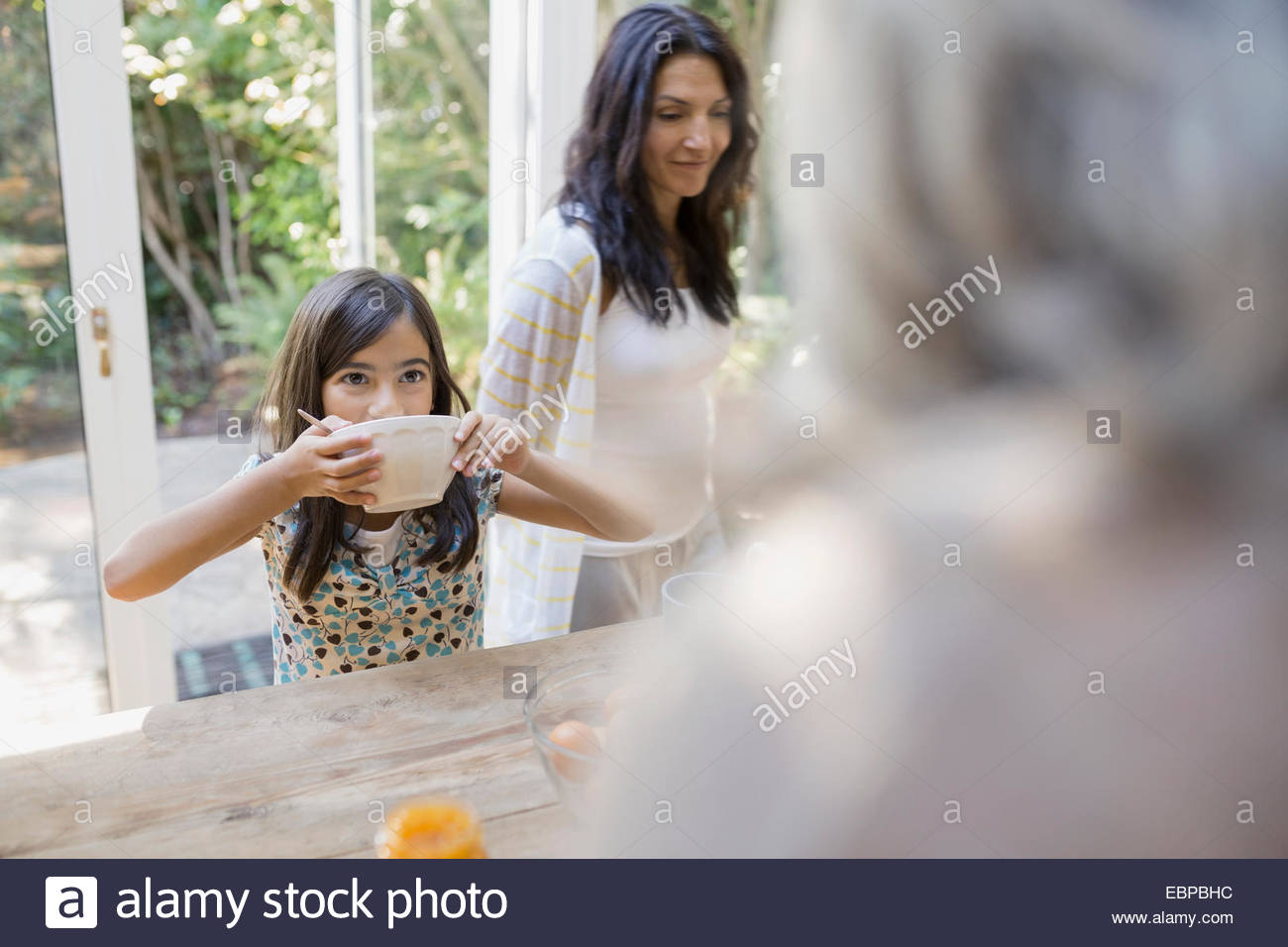 Multi-generation family in kitchen - Stock Image