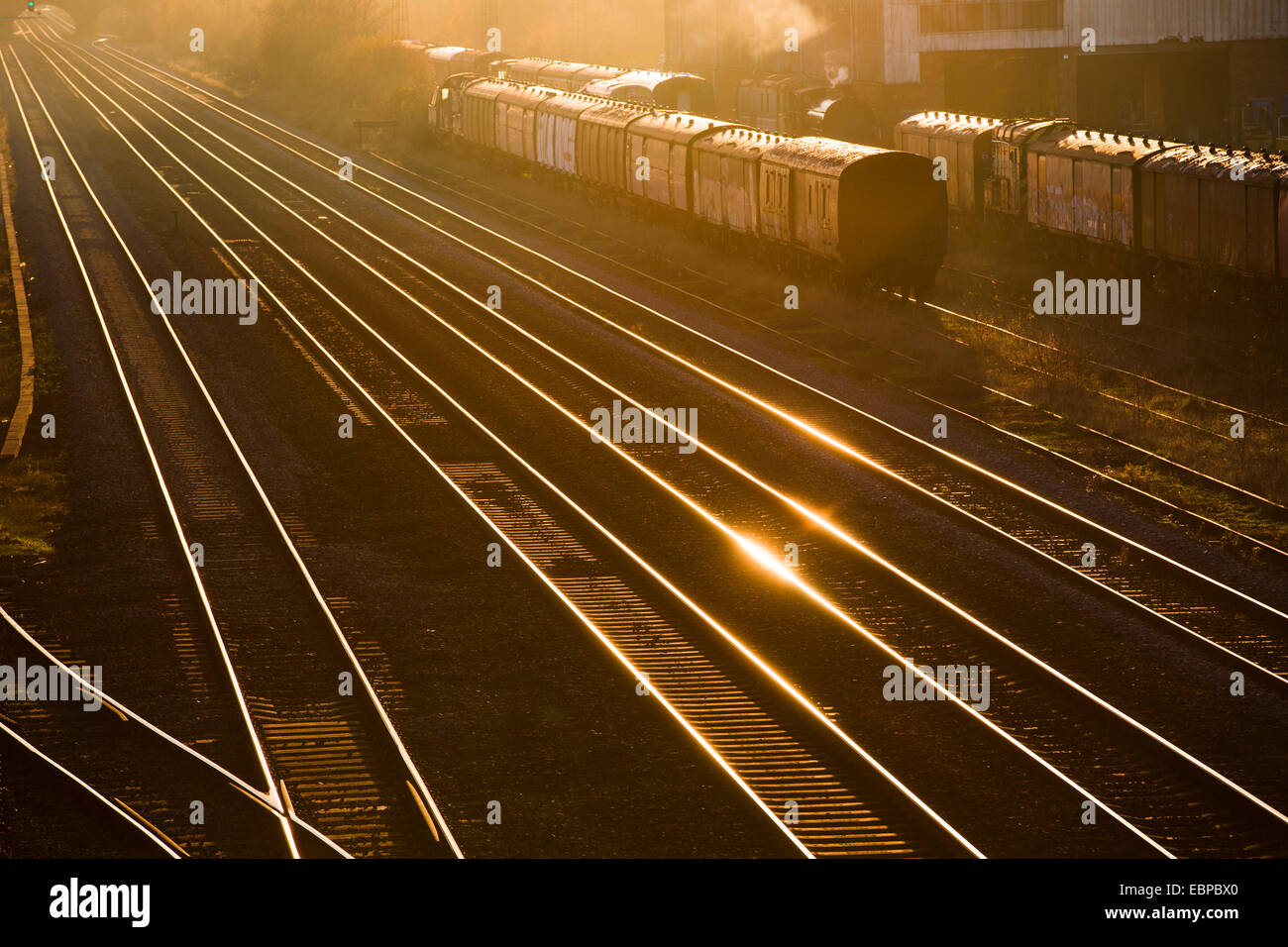 Railway lines at Burton-on-Trent, UK, in later afternoon winter sunshine. - Stock Image