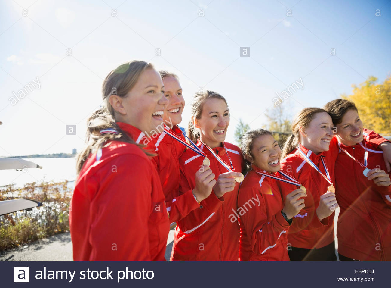 Rowing team with medals celebrating - Stock Image