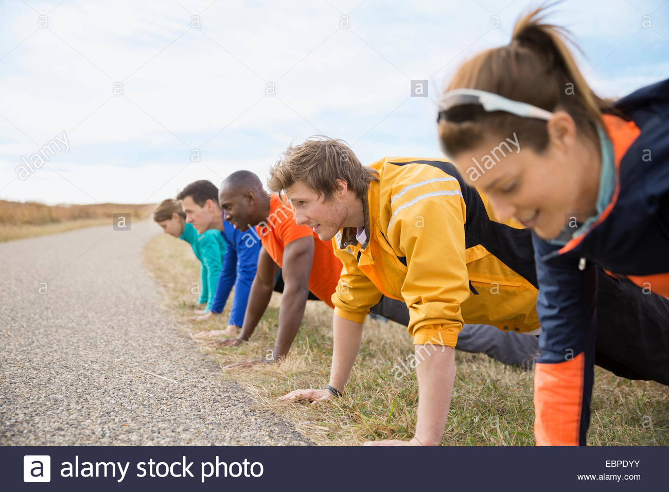 Group doing push-ups in a row - Stock Image