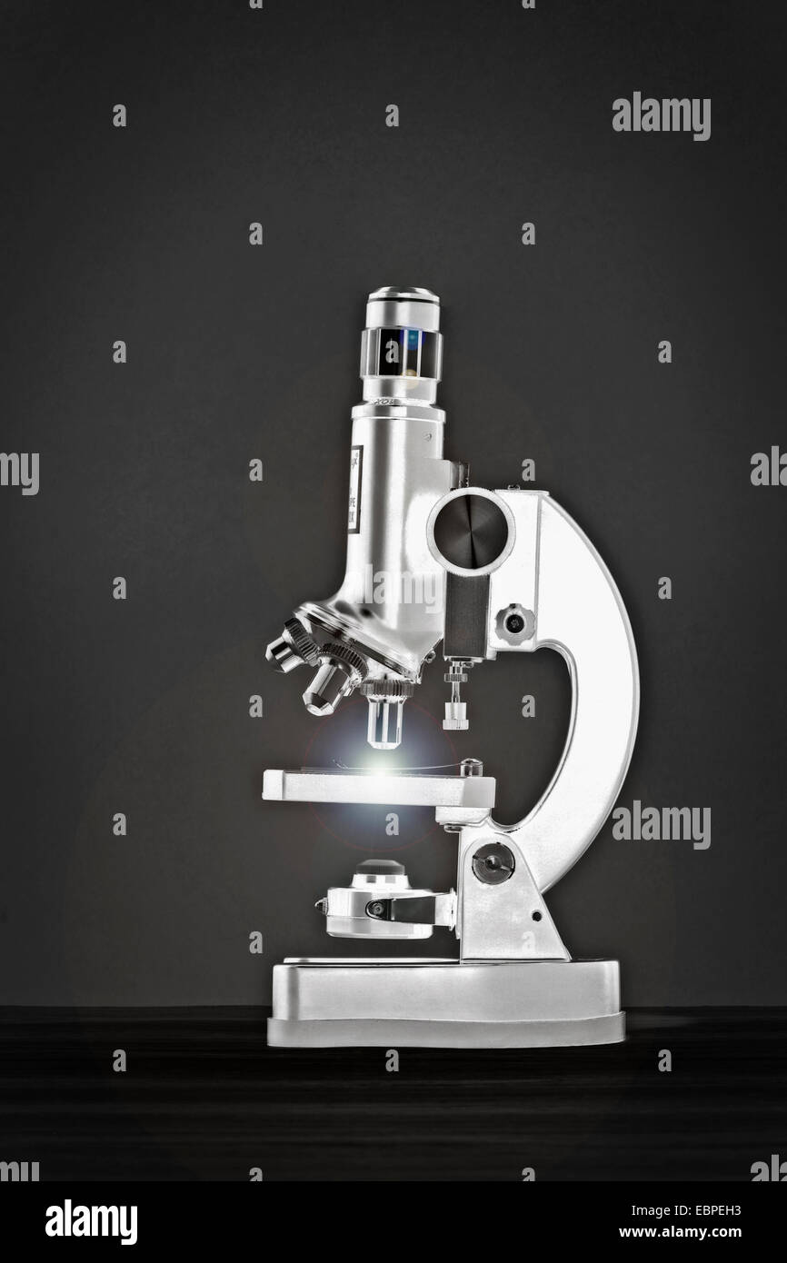 Close up of glowing microscope - Stock Image