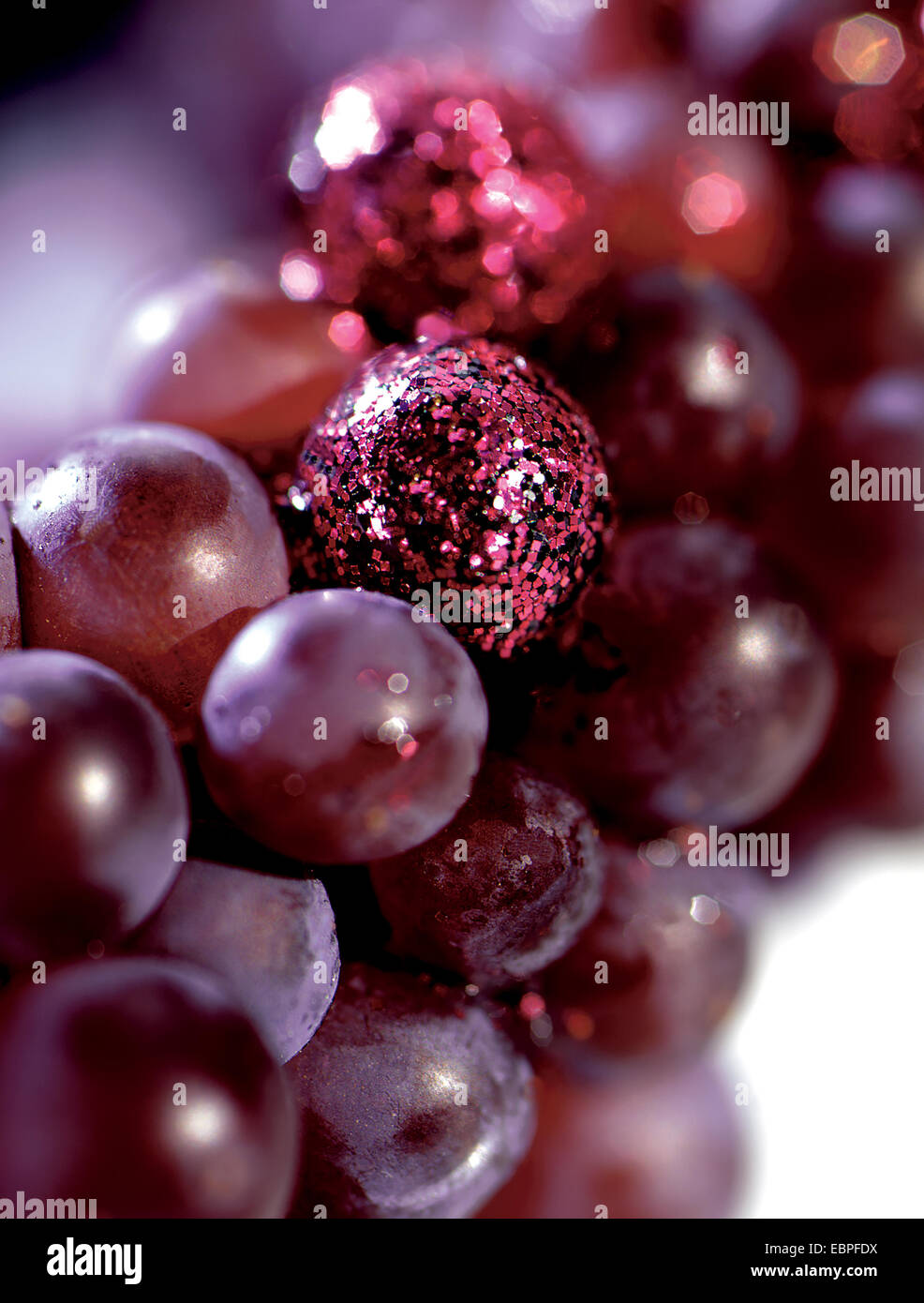 Red grapes with sparkle added to them - Stock Image