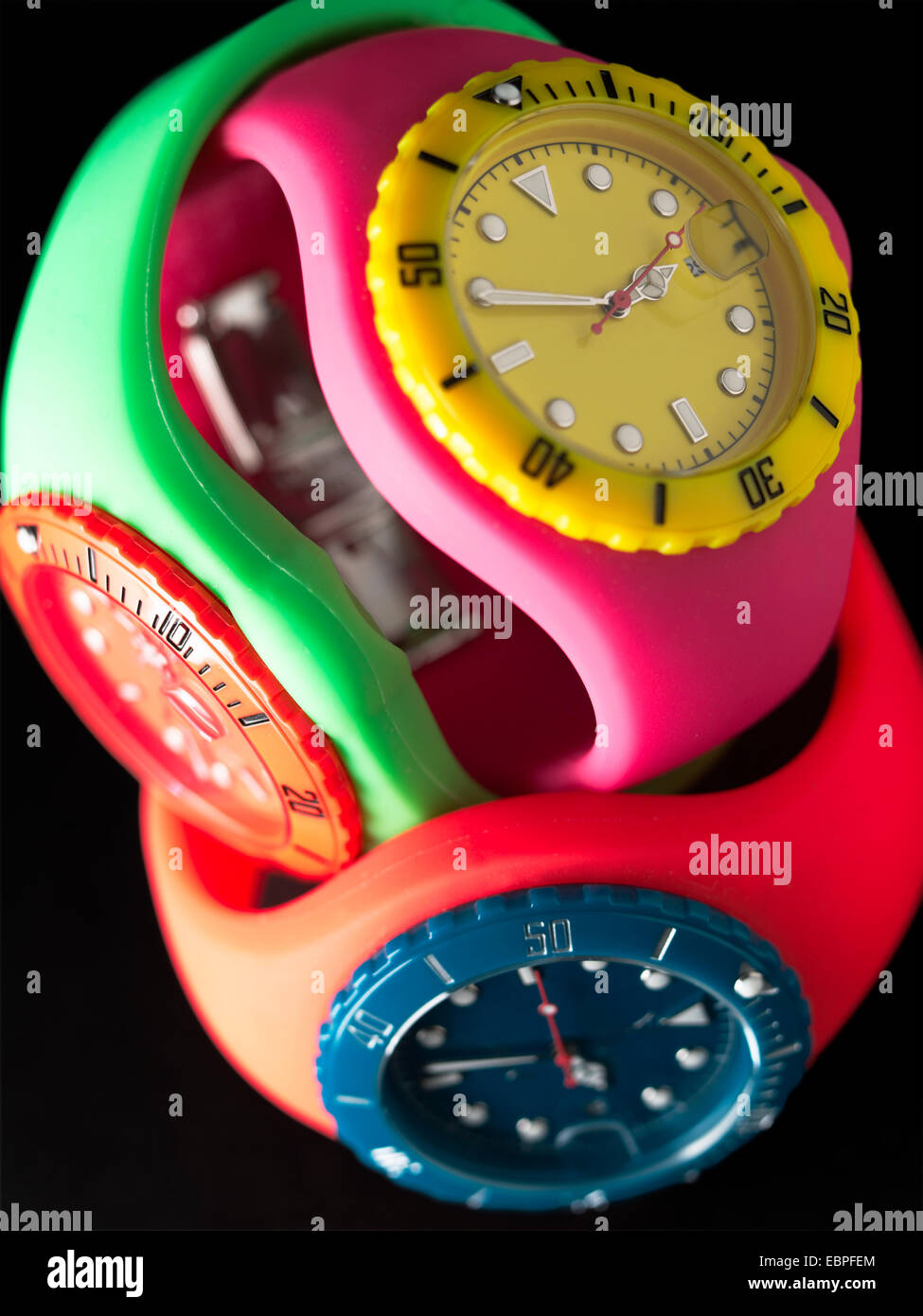 3 sports watches in neon colors - Stock Image