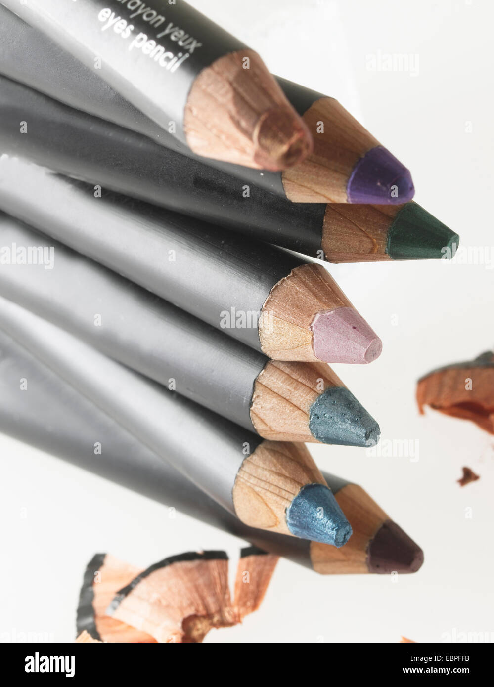 multi color womens eye liner makeup green purple pink pencils - Stock Image