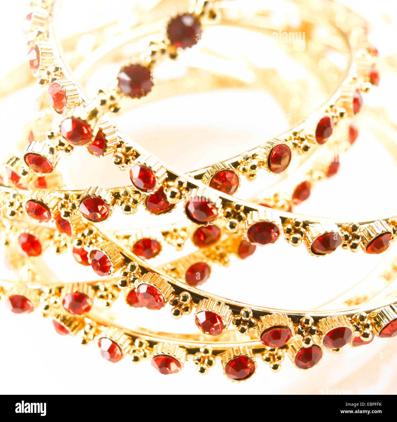 gold and red ruby bangles womens bracelet - Stock Image