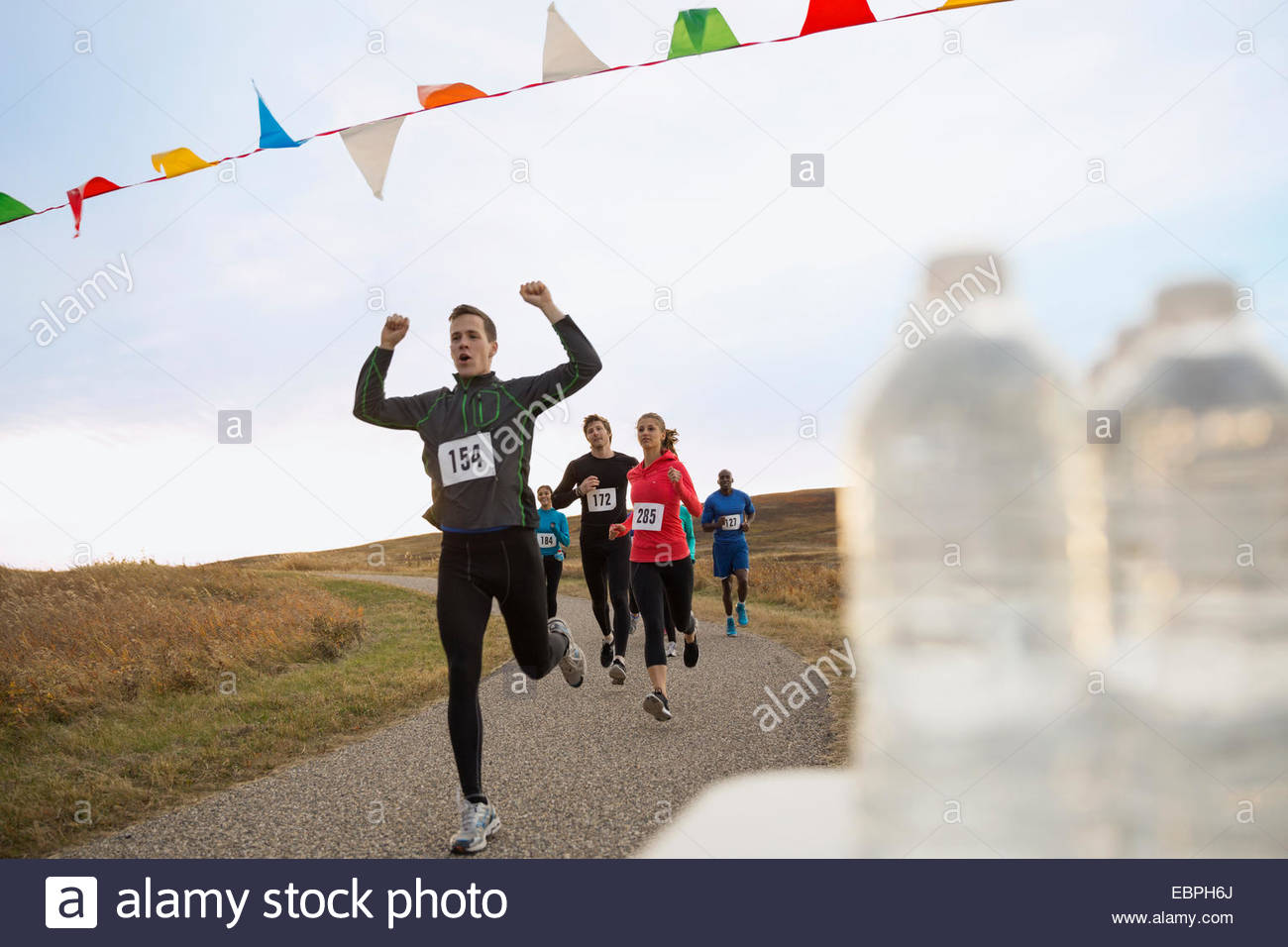 Cheering runner approaching finish line - Stock Image