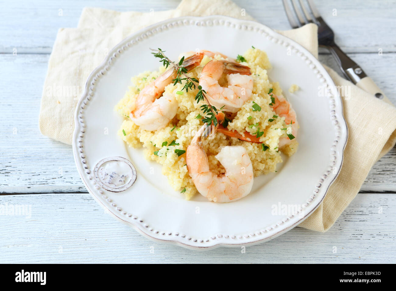 Couscous with seafood on a plate, tasty food - Stock Image