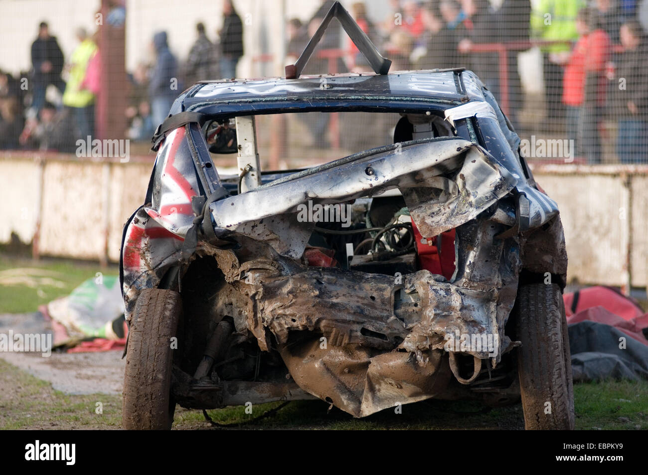 smashed up old junk car cars demolition derbies derby destruction demo dent dented bent crash crashed bent twisted - Stock Image