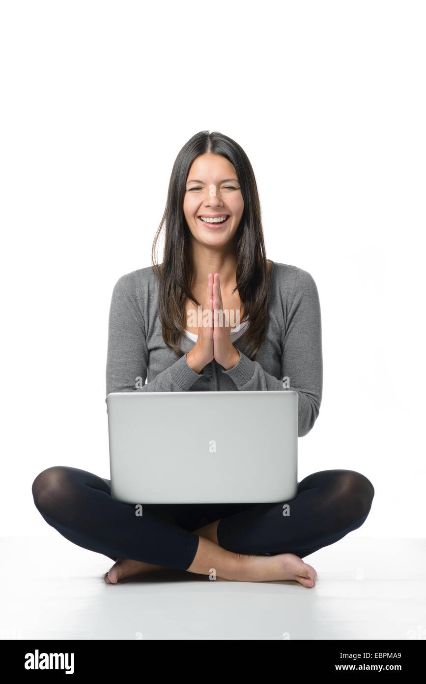 Happy Young Woman Meditating With Her Laptop Sitting Cross