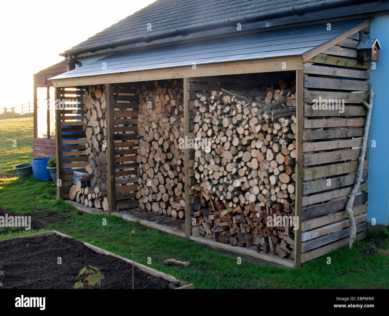 Wood Log Store On Side Of House, Widemouth Bay, Bude, Cornwall, UK