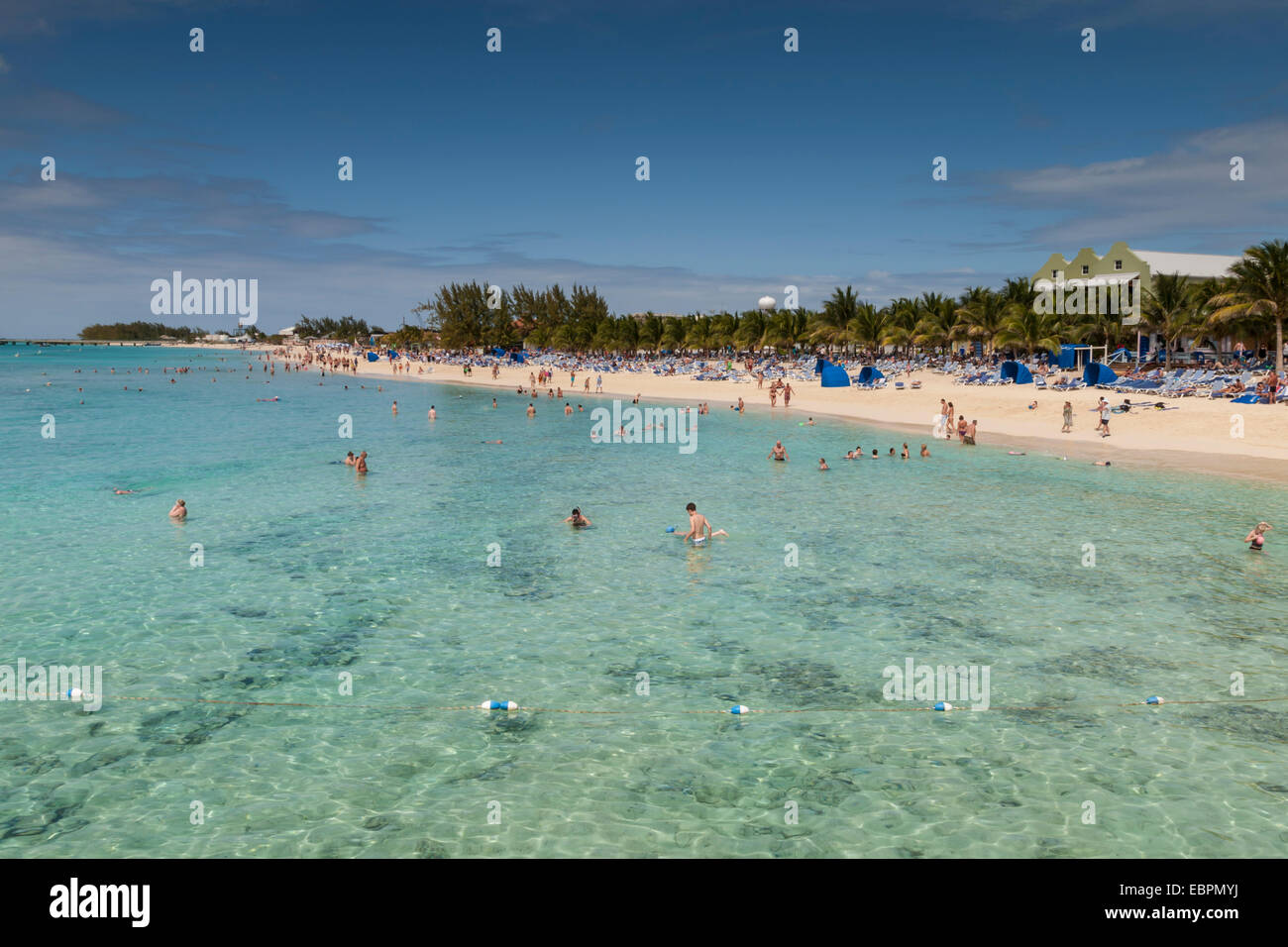 Busy beach and seashore with paddlers and snorkelers, cruise terminal, Grand Turk, Turks and Caicos, West Indies, - Stock Image