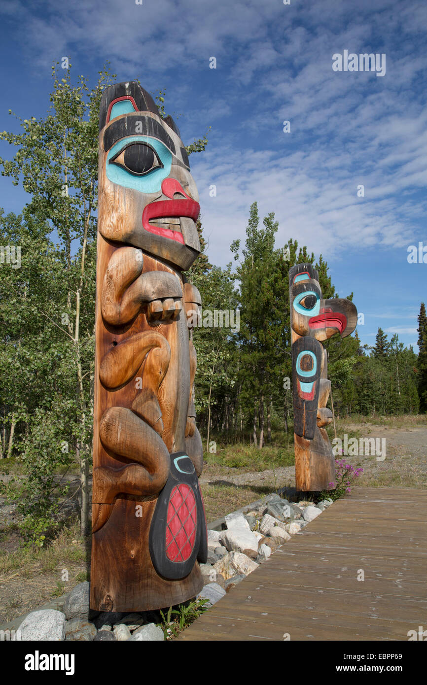Totem poles with beaver image in the foreground, Teslin Tlingit Heritage Center, Teslin, Yukon, Canada, North America - Stock Image