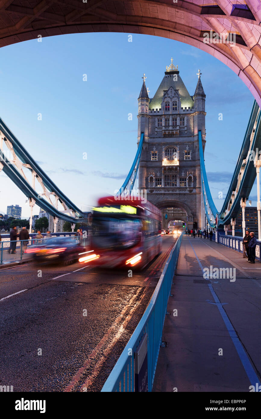 Red bus on Tower Bridge, London, England, United Kingdom, Europe - Stock Image