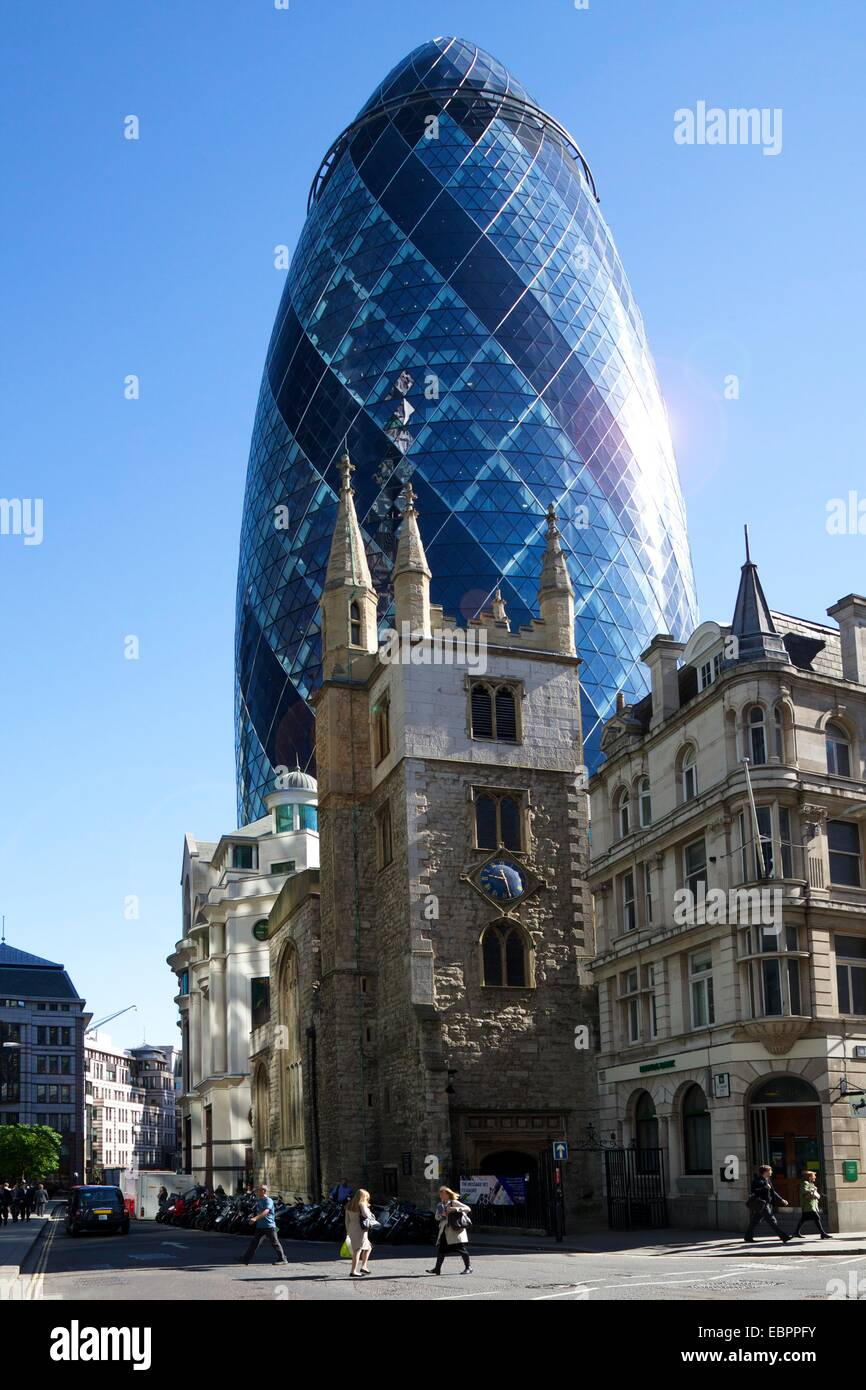 30 St Mary Axe (The Gherkin) with St. Andrew Undershaft church, City of London, England, United Kingdom, Europe - Stock Image