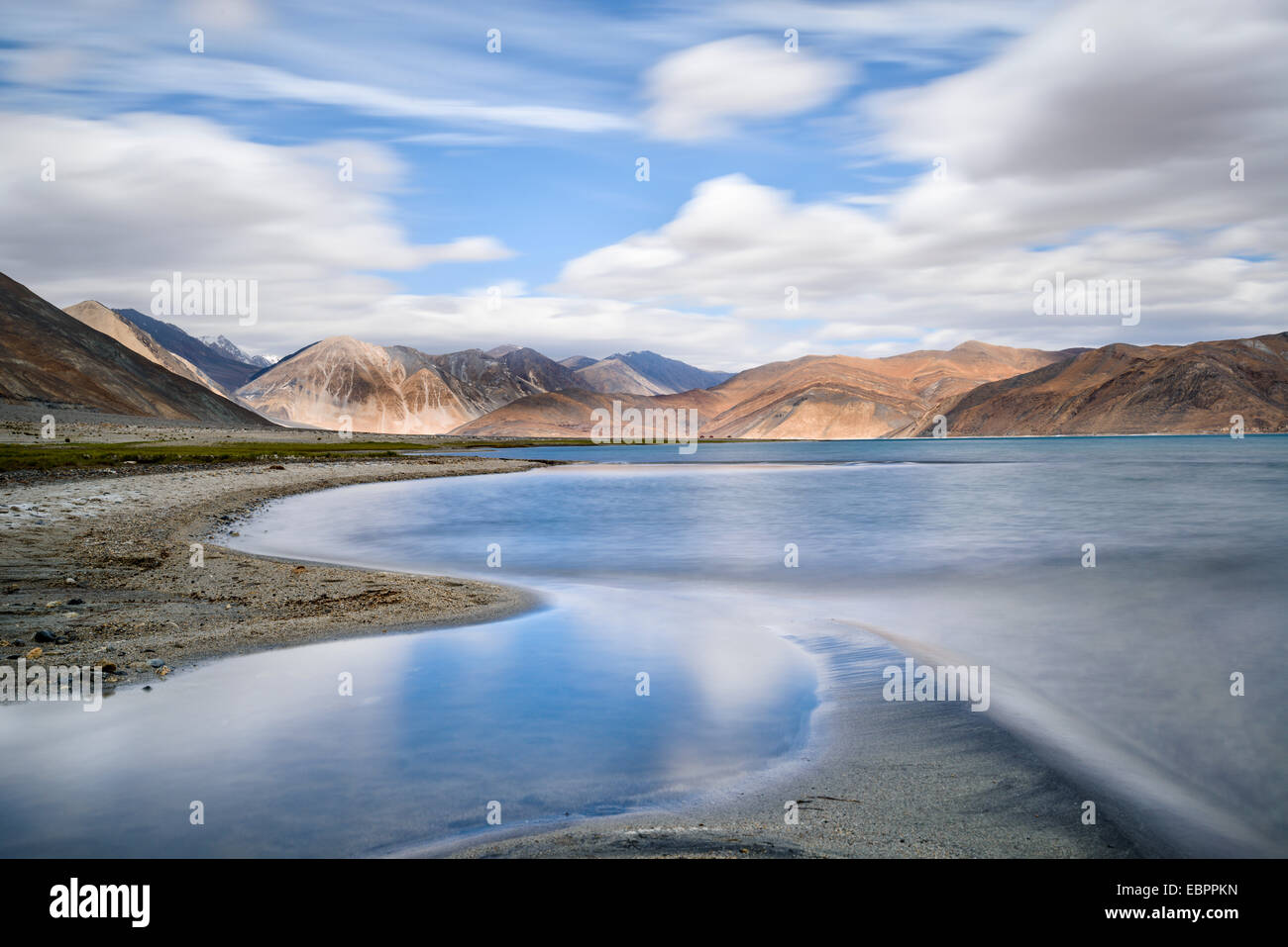The turquoise, saline water of Tso Pangong, backed by mountains, Ladakh, India, Asia - Stock Image