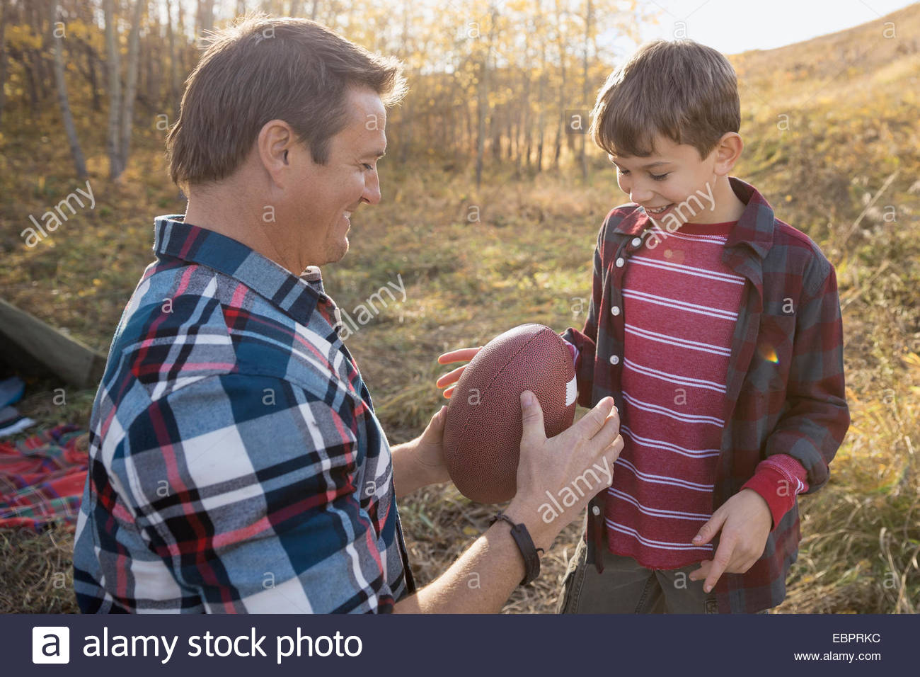 Father and son with football at campsite Stock Photo