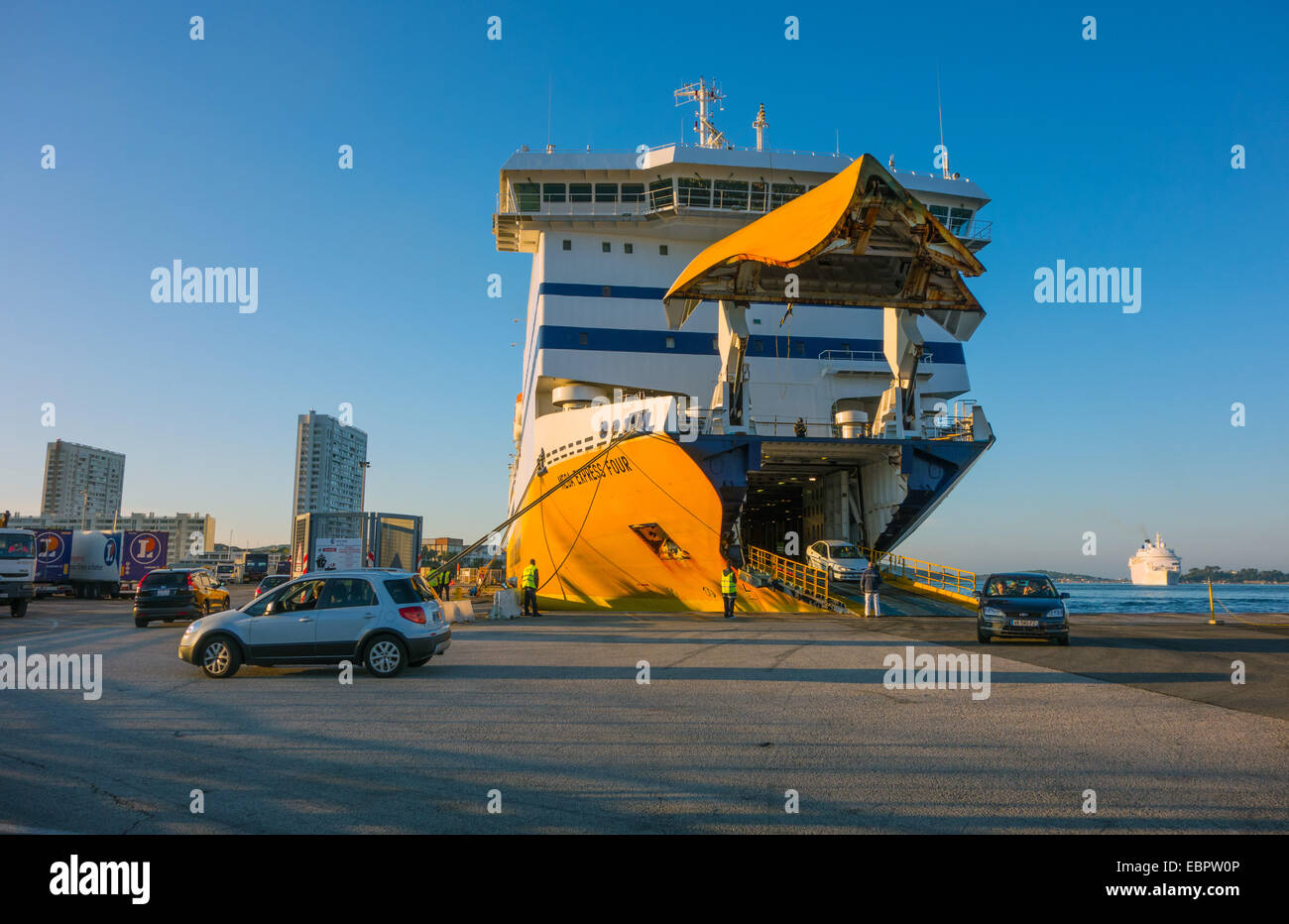 Yellow Roll-on Roll-off Ro Ro Ferry with bow lifted - Stock Image