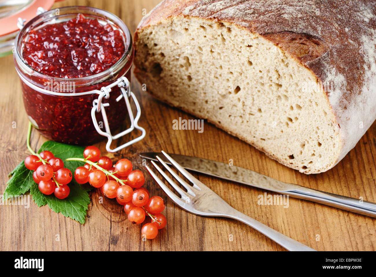 red currant jam and fresh bread - Stock Image