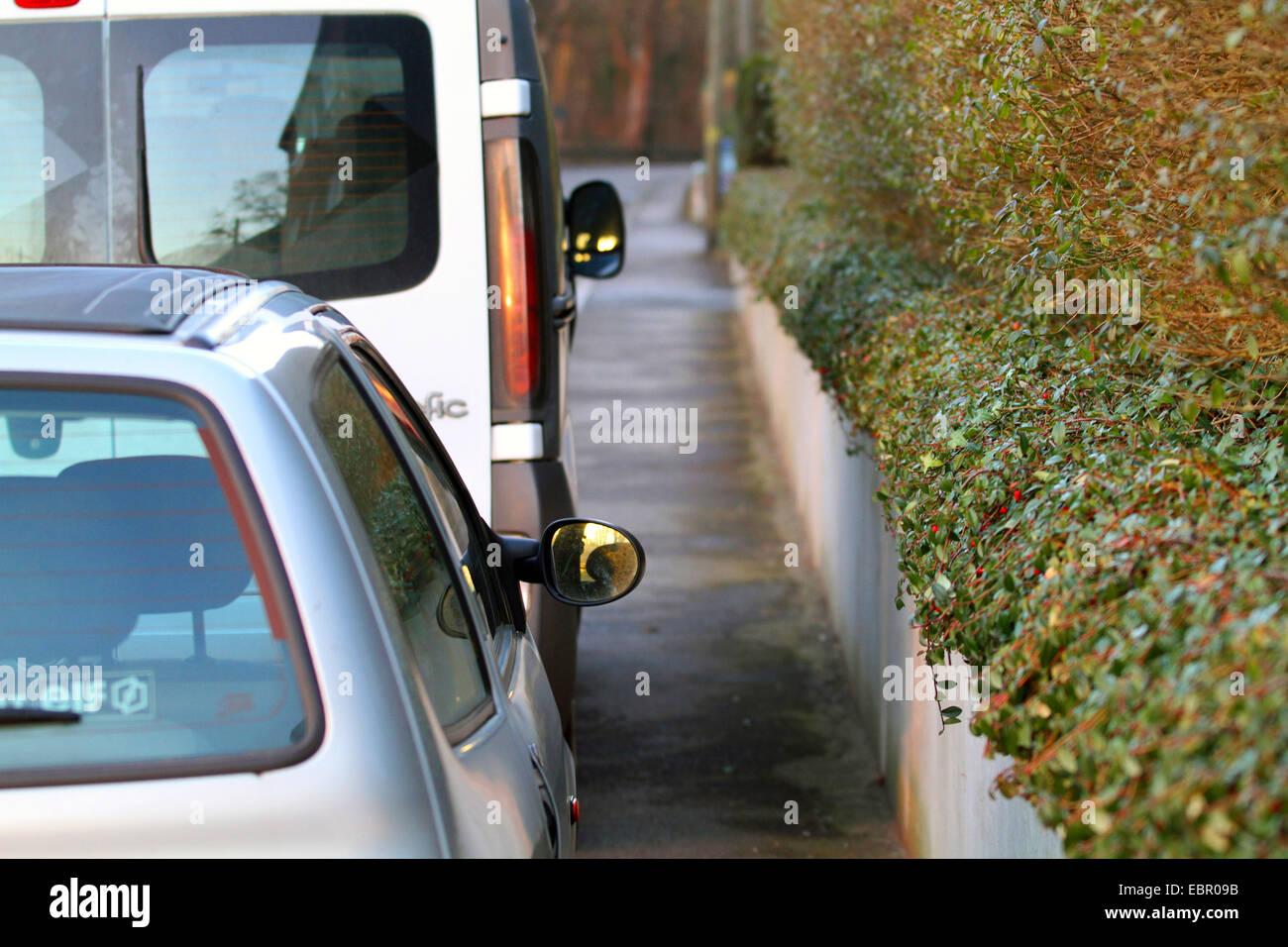 parked cars on sidewalk, Germany - Stock Image