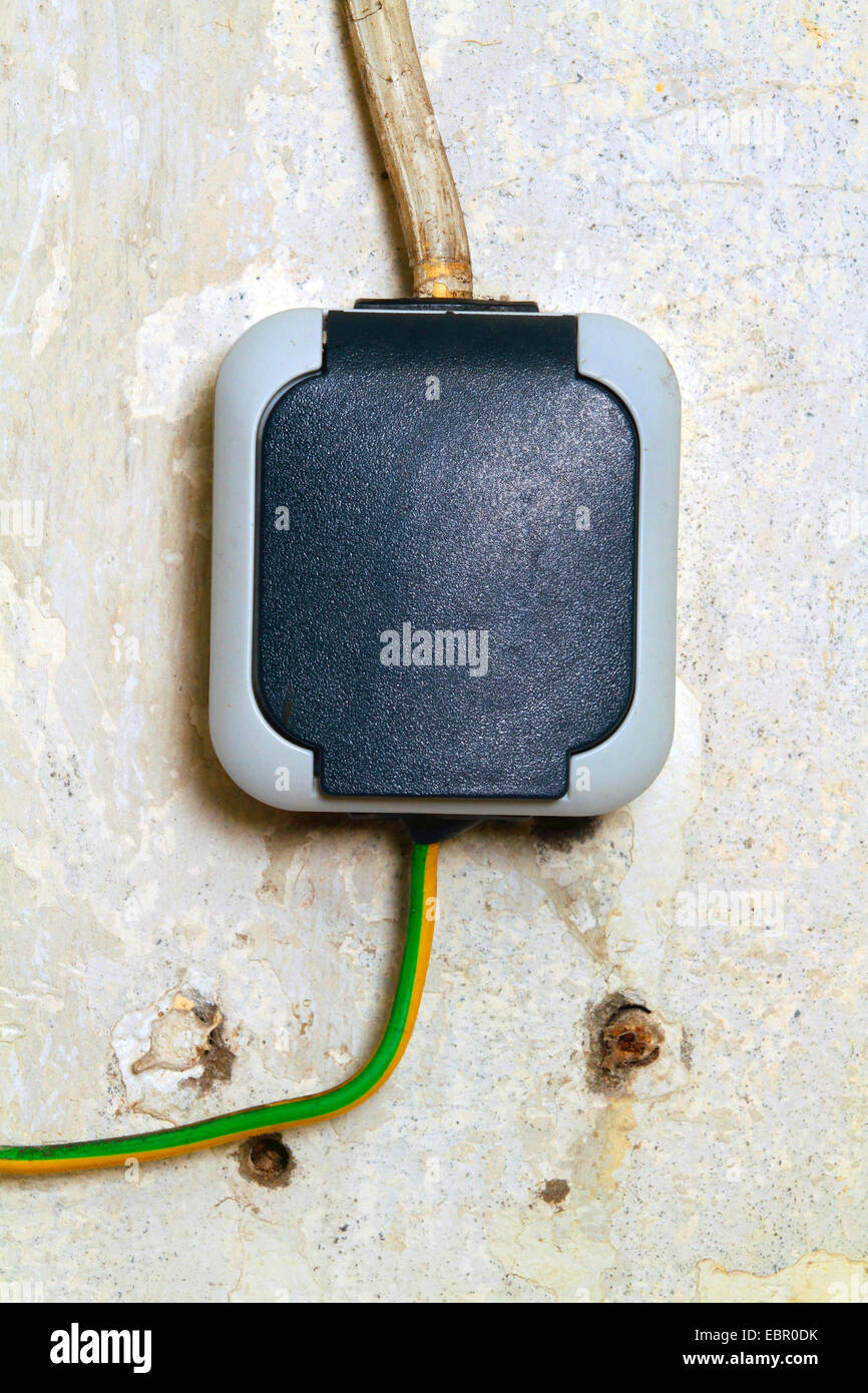 plug with protection against moisture - Stock Image