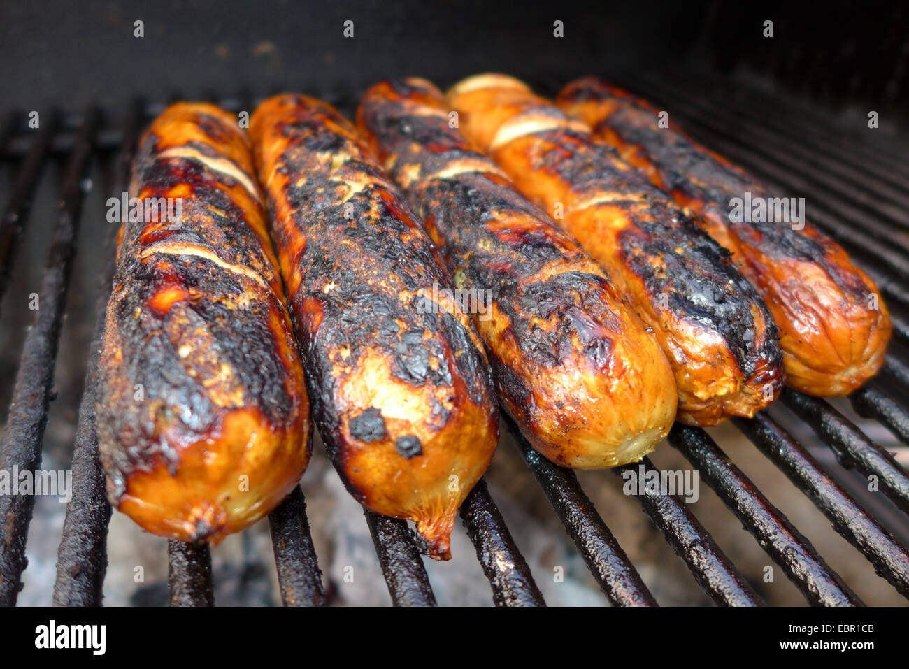 barbecue sausages on a grill - Stock Image