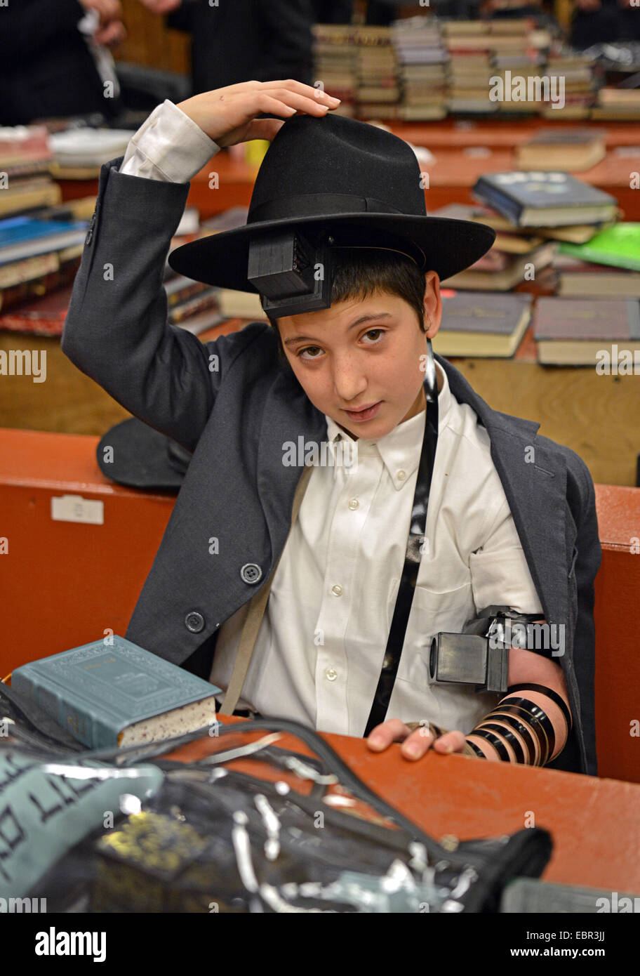 A religious Jewish boy who is almost 13 on the first day he put on phylacteries - teffilin - in Crown Heights Brooklyn, - Stock Image