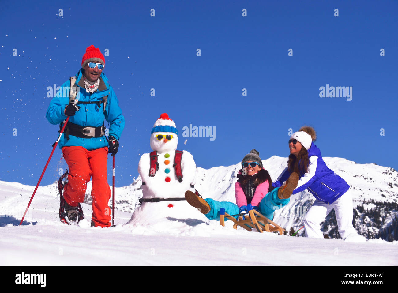 Family in snow holidays, France - Stock Image