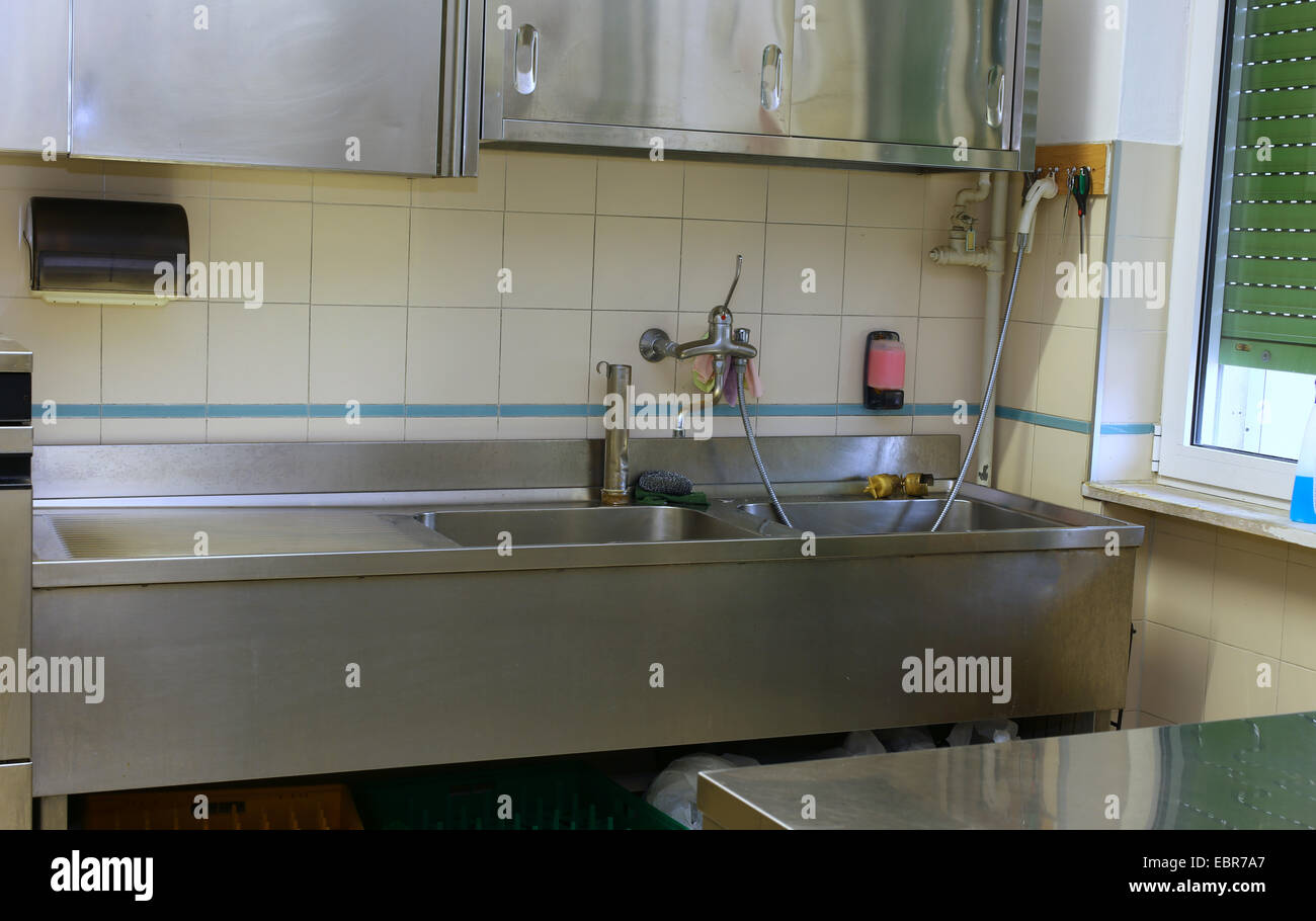 Steel sink and the Workbench in an industrial kitchen in the ...